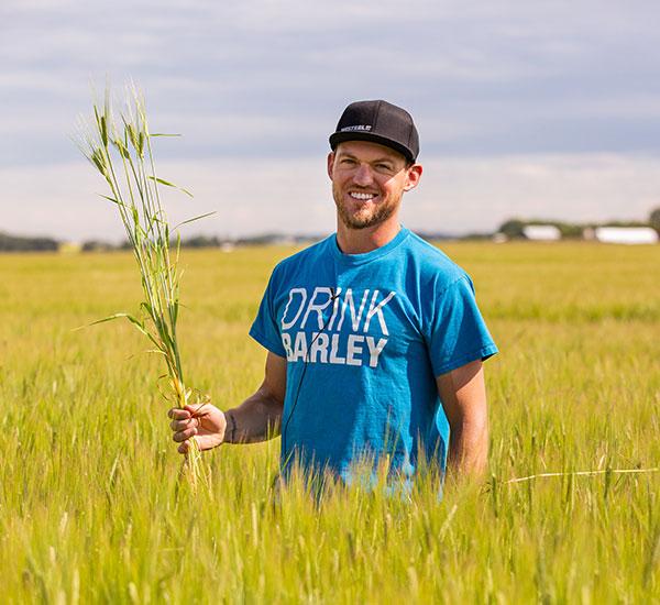 made in canada crop tour facilitator standing in field